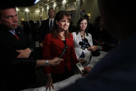 Republican Senate candidate Christine O'Donnell talks to reporters about her loss to Democratic candidate Chris Coons at her election night rally in Dover, Delaware, November 2, 2010. REUTERS/Jason Reed