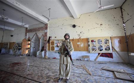 A paramilitary soldier secures the site of a sucide bomb attack inside a mosque in Jamrud, located in Pakistan's Khyber region August 19, 2011. REUTERS/Fayaz Aziz