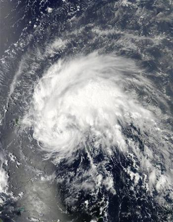 Tropical storm Irene approaches Puerto Rico (L) in this image taken from the MODIS instrument on NASA's Aqua satellite on August 21, 2011. REUTERS/NASA Goddard MODIS Rapid Response Team/Handout