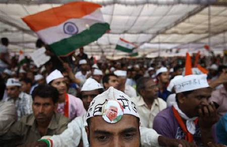 A supporter of veteran Indian social activist Anna Hazare wears a badge with his photo, on the seventh day of Hazare's fast at Ramlila grounds in New Delhi August 22, 2011. REUTERS/Adnan Abidi