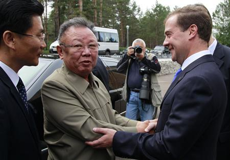 Russia's President Dmitry Medvedev (R) welcomes North Korean leader Kim Jong-il (C) at the ''Sosnovyi Bor'' military garrison in Siberia's Buryatia region August 24, 2011. REUTERS/Dmitry Astakhov/RIA Novosti/Kremlin