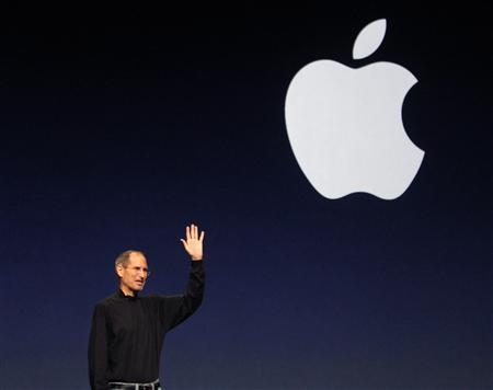 Steve Jobs waves at the conclusion of the launch of the iPad 2 on stage during an Apple event in San Francisco, California in this March 2, 2011 file photo. REUTERS/Beck Diefenbach/Files
