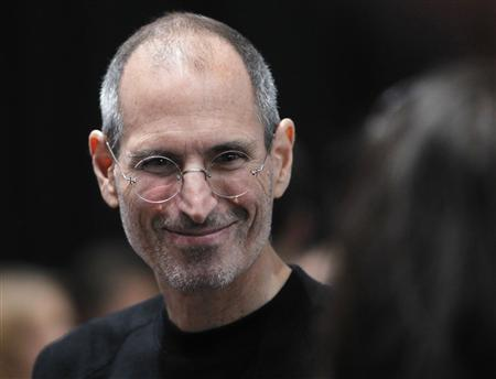 Steve Jobs smiles after Apple's music-themed September media event in San Francisco, California in this September 1, 2010 file photograph. REUTERS/Robert Galbraith/Files