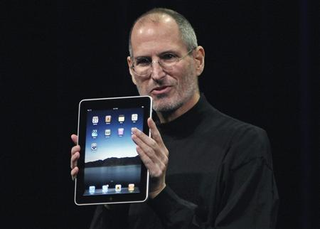 Steve Jobs holds the new ''iPad'' during the launch of Apple's new tablet computing device in San Francisco, California, in this January 27, 2010 file photograph. REUTERS/Kimberly White/Files