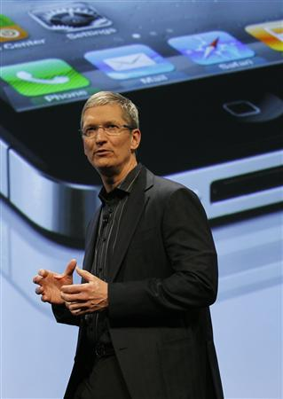 Apple's Chief Operating Officer Tim Cook speaks during Verizon's iPhone 4 launch event in New York in this January 11, 2011 file photograph. REUTERS/Brendan McDermid/Files