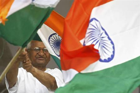 Veteran social activist Anna Hazare waves India's national flag on the tenth day of his fasting at the Ramlila grounds in New Delhi August 25, 2011.  REUTERS/Adnan Abidi/Files