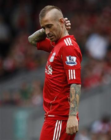 Liverpool's Raul Meireles holds his head during their English Premier League football match against Sunderland at Anfield in Liverpool, northern England August 13, 2011. REUTERS/Phil Noble
