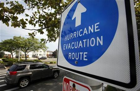 Cars drive past a Hurricane Evacuation Route sign in Long Beach on Long Island, New York, August 26, 2011. REUTERS/Mike Segar
