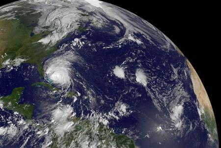 This NASA satellite image, released to Reuters August 25, 2011, shows Hurricane Irene (center left) moving through the Bahamas on August 25, 2011 at 10:02 a.m. EDT. REUTERS/NASA/Handout