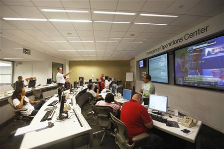 Officials at the American Red Cross in the Greater New York Emergency Operations Center discuss their preparations for the landfall of Hurricane Irene in New York August 25, 2011. REUTERS/Lucas Jackson