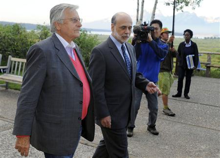Federal Reserve Chairman Ben Bernanke (R) walks with European Central Bank (ECB) President Jean-Claude Trichet at the Federal Reserve Bank of Kansas City Economic Policy Symposium in Jackson Hole, Wyoming, August 26, 2011. REUTERS/Price Chambers