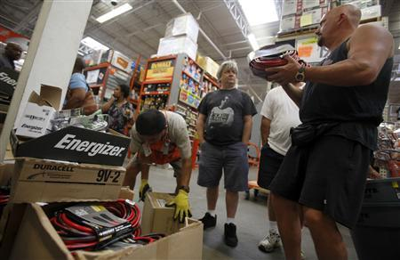 People shop for supplies to weather approaching Hurricane Irene at a Home Depot store in Freeport on Long Island, New York August 26, 2011. REUTERS/Mike Segar