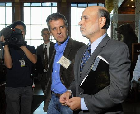 Federal Reserve Chairman Ben Bernanke speaks with Professor of International Economics at Catholic University of Buenos Aires Martin Redrado as they exit the Federal Reserve Bank of Kansas City Economic Policy Symposium in Jackson Hole, Wyoming, August 26, 2011. REUTERS/Price Chambers
