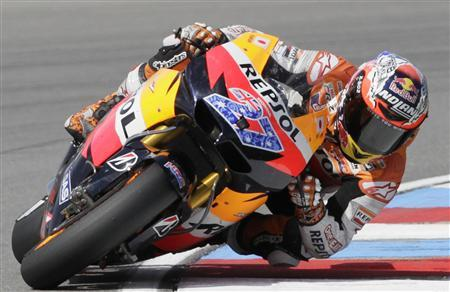 Honda MotoGP rider Casey Stoner of Australia rides to win the Czech Grand Prix in Brno August 14, 2011. REUTERS/David W Cerny