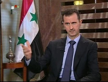 A still image taken from video shows Syria's President Bashar Assad speaking during an interview with state television in Damascus August 21, 2011. REUTERS/Syrian TV/Reuters TV
