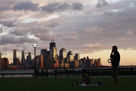 With the skyline of New York in the bakground, people enjoy the sunset at the Erie-Lackawanna Park along Hudson river after the pass of Hurricane Irene at Hoboken in New Jersey August 28, 2011. REUTERS/Eduardo Munoz