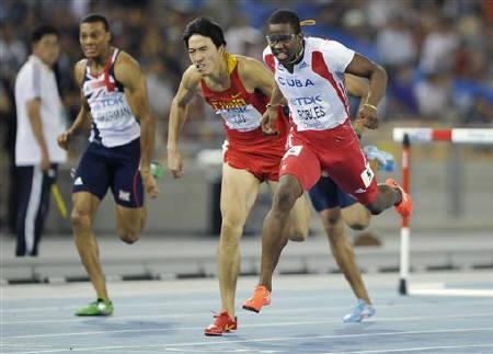 Dayron Robles of Cuba crosses the finish line ahead of Liu Xiang of China (C) and William Sharman of Britain (L) to win the men's 110 metres hurdles final at the IAAF 2011 World Championships in Daegu August 29, 2011. REUTERS/Dylan Martinez