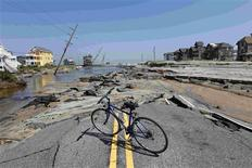 <p>A bike is parked on Hwy 12, the main road that connects Cape Hatteras National Seashore to the mainland, after it was destroyed by Hurricane Irene in Rodanthe, North Carolina, August 28, 2011. REUTERS/Jose Luis Magana</p>