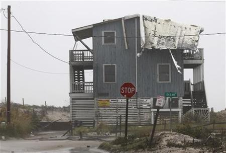 The roof of an ocean front house is destroyed by strong winds from Hurricane Irene at Cape Hatteras National Seashore in Rodanthe, North Carolina August 27, 2011.REUTERS/Jose Luis Magaua