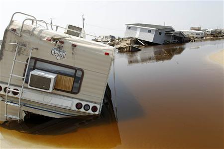 A trailer sits on the beach at the North Beach Campground after being washed out by Hurricane Irene, at Cape Hatteras National Seashore in Rodanthe, North Carolina August 29, 2011. REUTERS/Jose Luis Magana