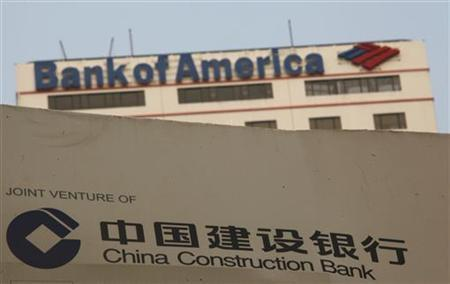 A construction site of the Hong Kong headquarters of China Construction Bank (Asia) is seen in front of Bank of America Tower at Hong Kong's financial Central district August 25, 2011. REUTERS/Bobby Yip