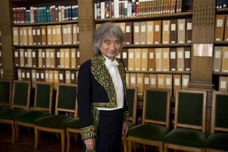 Japan's maestro Seiji Ozawa poses prior to a ceremony to take up his seat at France's academy of fine arts in Paris September 24, 2008. REUTERS/Philippe Wojazer