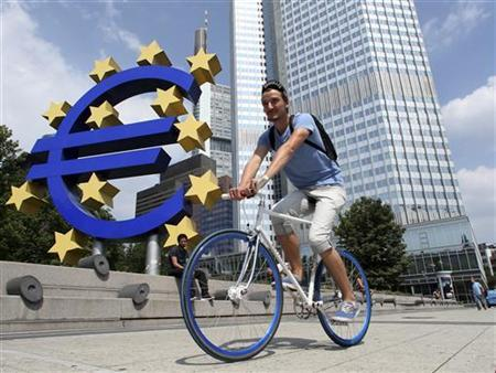 A cyclist rides past the European Central Bank (ECB) headquarters in Frankfurt, August 4, 2011. REUTERS/Ralph Orlowski