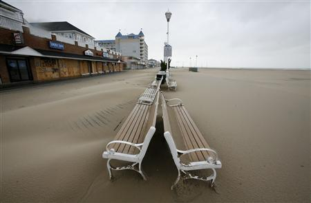 Sand covers the board walk after Hurricane Irene passed through in Ocean City, Maryland, August 28, 2011. REUTERS/Molly Riley