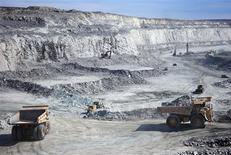 <p>Hydraulic excavators scoop the broken rock into 100- or 150-tonne haul trucks at Agnico-Eagle's Meadowbank Mine in Nunavut, Canada, photographed on June 28, 2011. REUTERS/Euan Rocha</p>