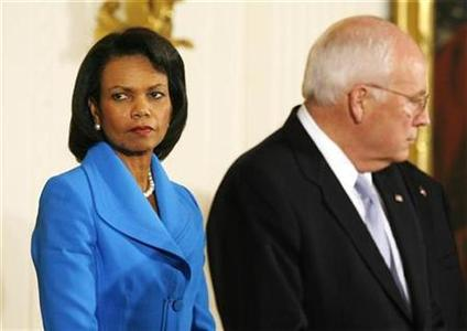 Condoleezza Rice (L) and Dick Cheney stand by as George W. Bush (not pictured) speaks during a signing ceremony for the United States-India Nuclear Cooperation Approval and Non-proliferation Enhancement Act in the East Room of the White House in Washington October 8, 2008. REUTERS/Kevin Lamarque