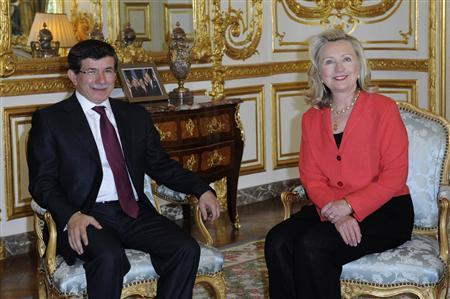 Secretary of State Hillary Clinton (R) and Turkish Foreign Minister Ahmet Davutoglu attend a bilateral meeting ahead of the ''Friends of Libya'' conference in Paris September 1, 2011. REUTERS/Gonzalo Fuentes