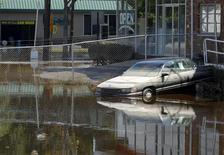<p>The area around the Wayne auto dealership is seen flooded in Wayne, New Jersey, September 1, 2011, a few days after Hurricane Irene. REUTERS/ Mark Dye</p>