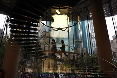 People walk inside an Apple retail store in Shanghai August 25, 2011. REUTERS/Aly Song