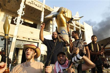 Libyan rebels celebrate at Bab Al-Aziziya compound in Tripoli August 23, 2011. REUTERS/Louafi Larbi