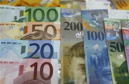 Various Euro banknotes next to various Swiss Franc notes at a bank in Warsaw, July 18, 2011. REUTERS/Kacper Pempel/File