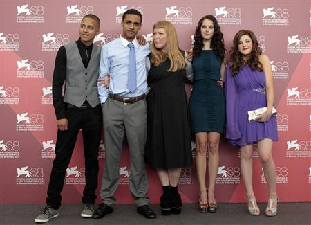 (L to R) Actors Solomon Glave, James Howson, director Andrea Arnold and actresses Kaya Scodelario and Shannon Beer pose during a photocall for her film ''Wuthering Heights'' at the 68th Venice Film Festival September 6, 2011. REUTERS/Alessandro Bianchi