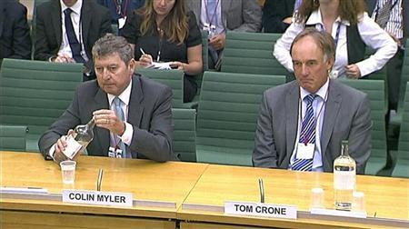 Former News of the World editor Colin Myler (L) and former News International legal manager Tom Crone sit before a parliamentary committee in London in this still image taken from a September 6, 2011 video by Parliament TV. REUTERS/Parbul TV via Reuters TV