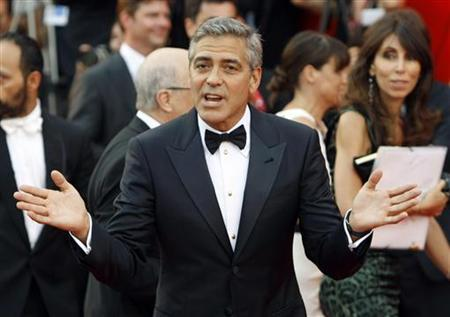 George Clooney gestures as he arrives on the ''The Ides of March'' red carpet at the 68th Venice Film Festival in Venice August 31, 2011. REUTERS/Alessandro Garofalo