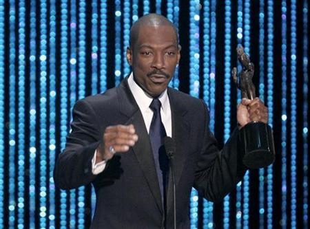 Eddie Murphy speaks after winning the award for outstanding performance by a male actor in a supporting role for his role in the film ''Dreamgirls'' at the 13th Annual Screen Actors Guild Awards in Los Angeles January 28, 2007. REUTERS/Robert Galbraith