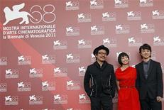 <p>Director Sion Sono (R) poses with cast members Shota Sometani (R) and Fumi Nikaidou (C) during a photocall for their film Himizu at the 68th Venice Film Festival, September 6, 2011. REUTERS/Eric Gaillard</p>