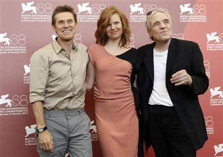 U.S. director Abel Ferrara (R) and actors Shanyn Leigh (2nd R) and Willem Dafoe smile as they pose during a photocall for their film ''4:44 Last Day on Earth'' at the 68th Venice Film Festival September 7, 2011. REUTERS/Alessandro Bianchi