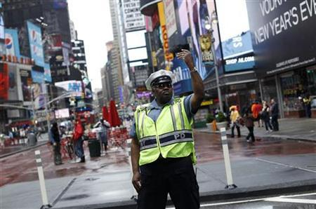A police officer gestures as he works in New York's Times Square May 3, 2010. REUTERS/Shannon Stapleton
