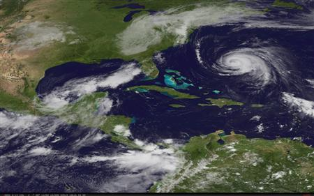 A low-pressure system in the far southwest of the Gulf of Mexico is visible as Hurricane Katia churns in the Atlantic, in a satellite image taken September 7, 2011. REUTERS/NOAA