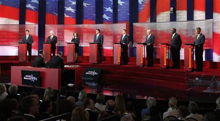 GOP presidential candidates (L-R): former Pennsylvania Senator Rick Santorum, former House of Representatives Speaker Newt Gingrich, Rep. Michele Bachmann (R-MN) , former Massachusetts Governor Mitt Romney, Texas Governor Rick Perry, Rep. Ron Paul, (R-TX), Herman Cain, and former U.S. ambassador to China Jon Huntsman stand on stage before the Reagan Centennial GOP presidential primary debate at the Ronald Reagan Presidential Library in Simi Valley, California, September 7, 2011. REUTERS/Mario Anzuoni