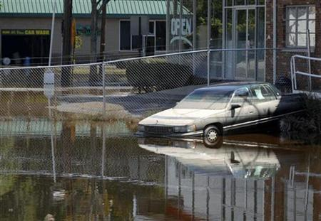 The area around the Wayne auto dealership is seen flooded in Wayne, New Jersey, a few days after Hurricane Irene, September 1, 2011. REUTERS/ Mark Dye
