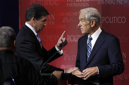 Texas Governor Rick Perry talks during a break with Rep. Ron Paul on stage at the Reagan Centennial GOP presidential primary debate at the Ronald Reagan Presidential Library in Simi Valley, California, September 7, 2011. REUTERS/Mario Anzuoni