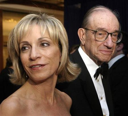 Federal Reserve Chairman Alan Greenspan and Andrea Mitchell of NBC arrive at the White House Correspondents dinner at the Washington Hilton in Washington, April 30, 2005. REUTERS/Hans Ericsson