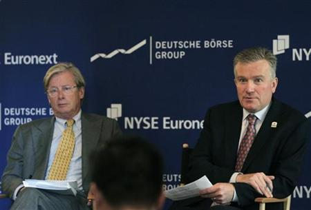 Jan-Michiel Hessels, (L) NYSE Euronext Chairman and Duncan Niederauer, NYSE Euronext CEO, speak to the media following a shareholders meeting at the New York Stock Exchange in New York, July 7, 2011. REUTERS/Brendan McDermid