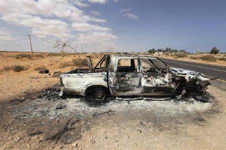 A pro-Gaddafi truck which was shelled and torched on Thursday is pictured on the front line in Teassain area, 90 km (56 miles) east of Sirte September 9, 2011. REUTERS/Esam Al-Fetori