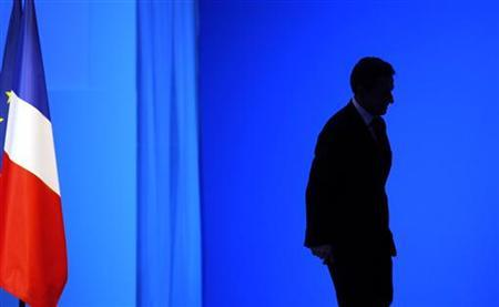 France's President Nicolas Sarkozy leaves after he delivered a speech to businessmen in Paris March, 16, 2011. REUTERS/Christophe Ena/Pool